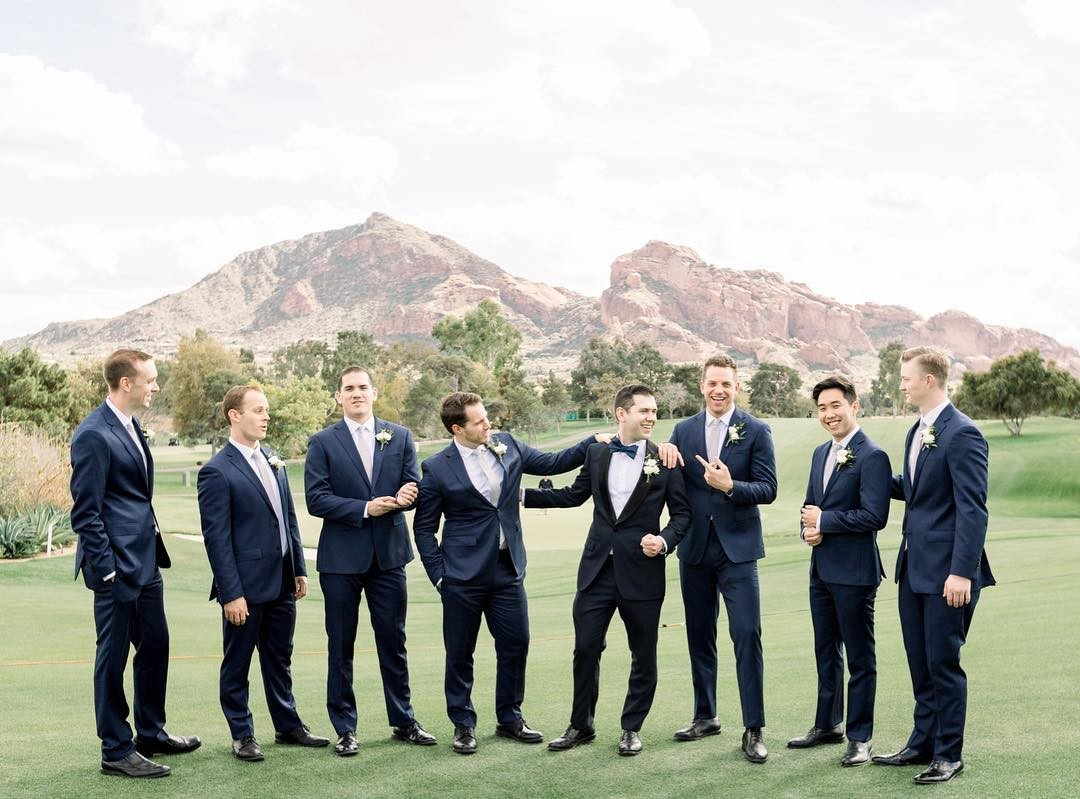 A line up of handsome groomsmen? Yes, please!