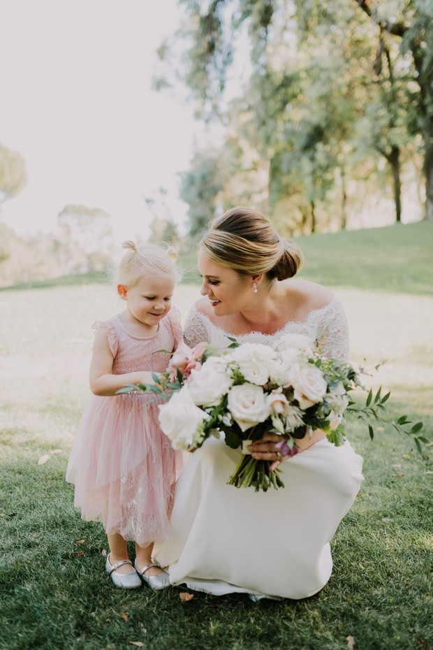 bride and pink flower girl