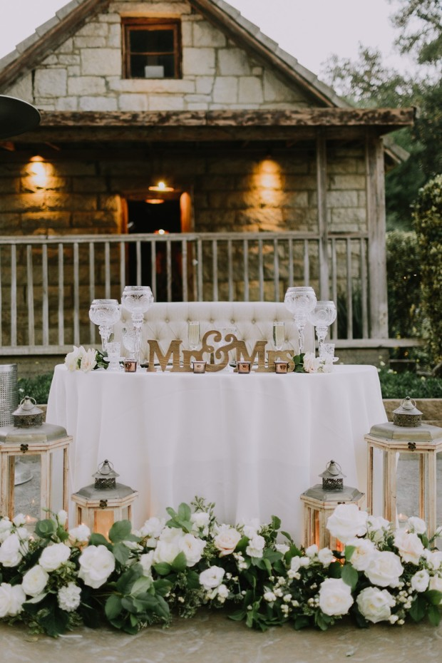 white and gold wedding sweetheart table