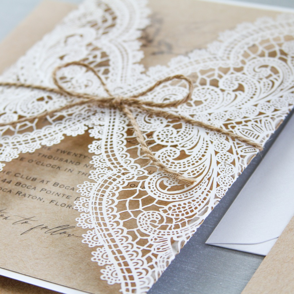 Love this rustic look, using the ivory laser-cut lace invitation tied with twine. Customize them to fit your wedding theme on our shop