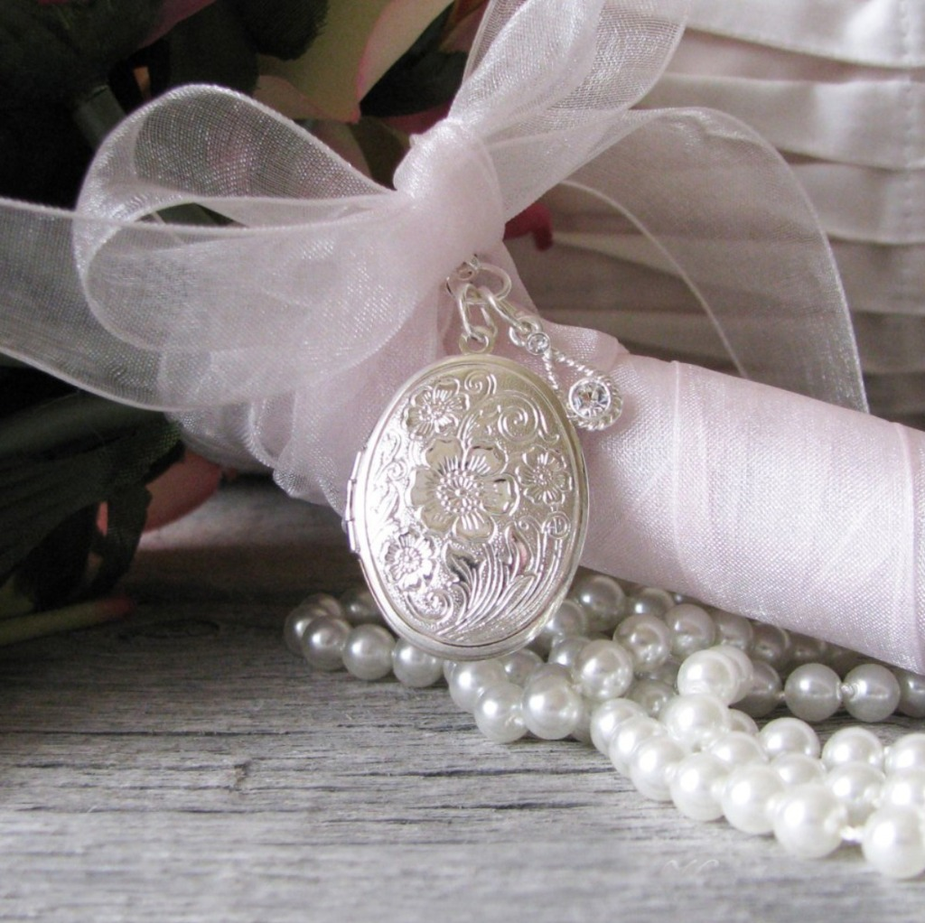 Carry a photo of a loved one with you down the aisle. I'll create a beautiful bouquet locket for your bouquet ( or boutonniere) with