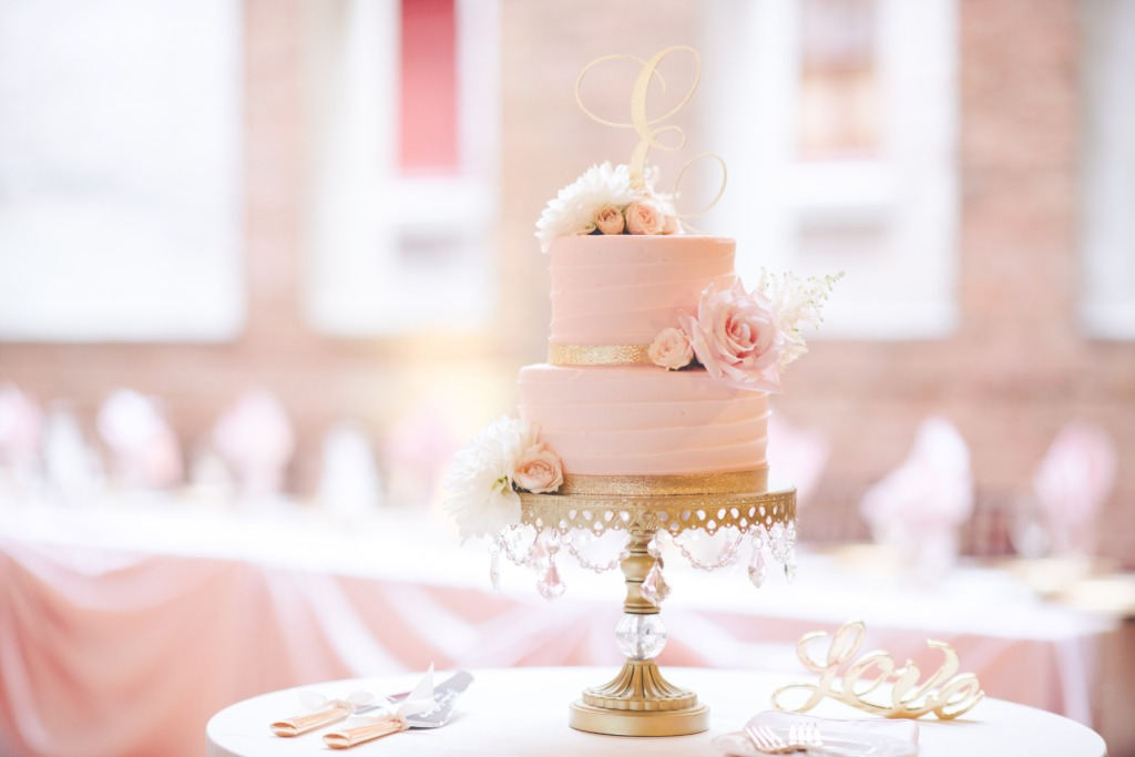 Gorgeous Blush Wedding Cake by @sugarontopbakeshop on Opulent Treasures gold chandelier wedding cake stand!