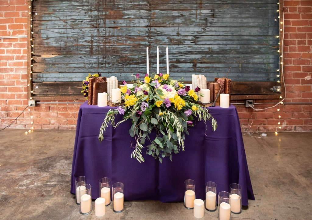 How magical is this sweetheart table? Our bride and groom are huge Harry Potter fans and wanted to incorporate some elements from the