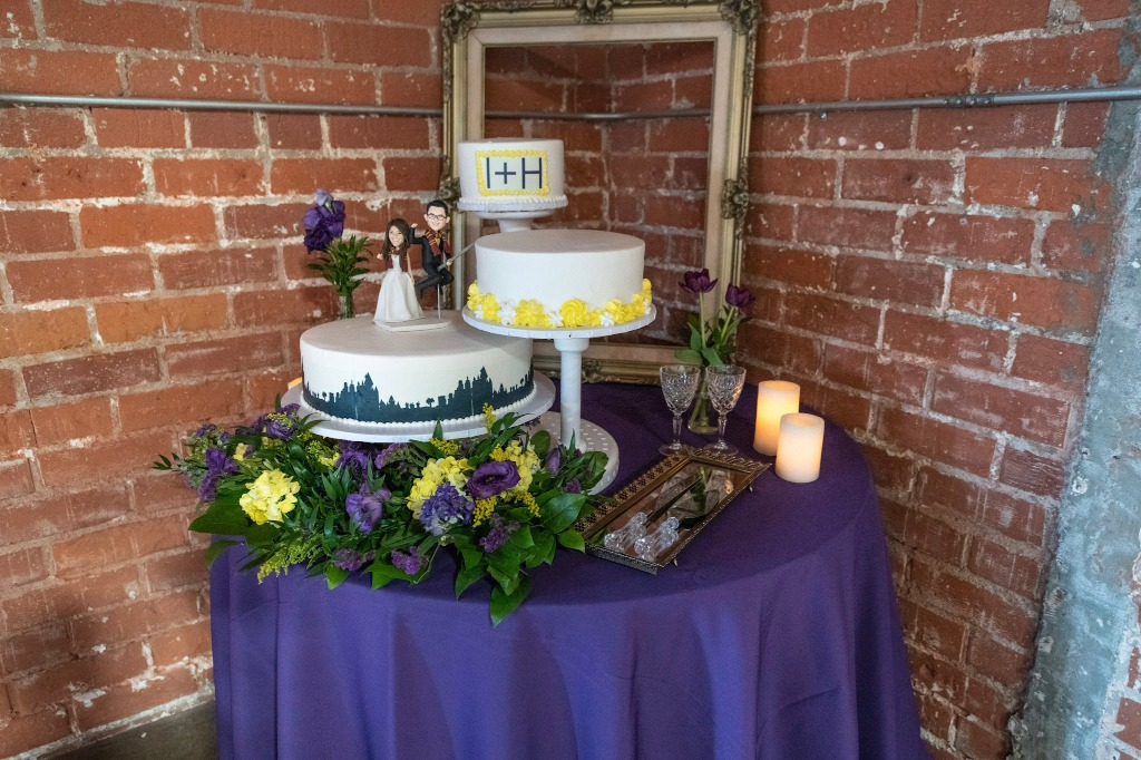 Want to shy away from the traditional stacked cake? Our couple had a three-tiered pillar styled cake stand, which we set up against