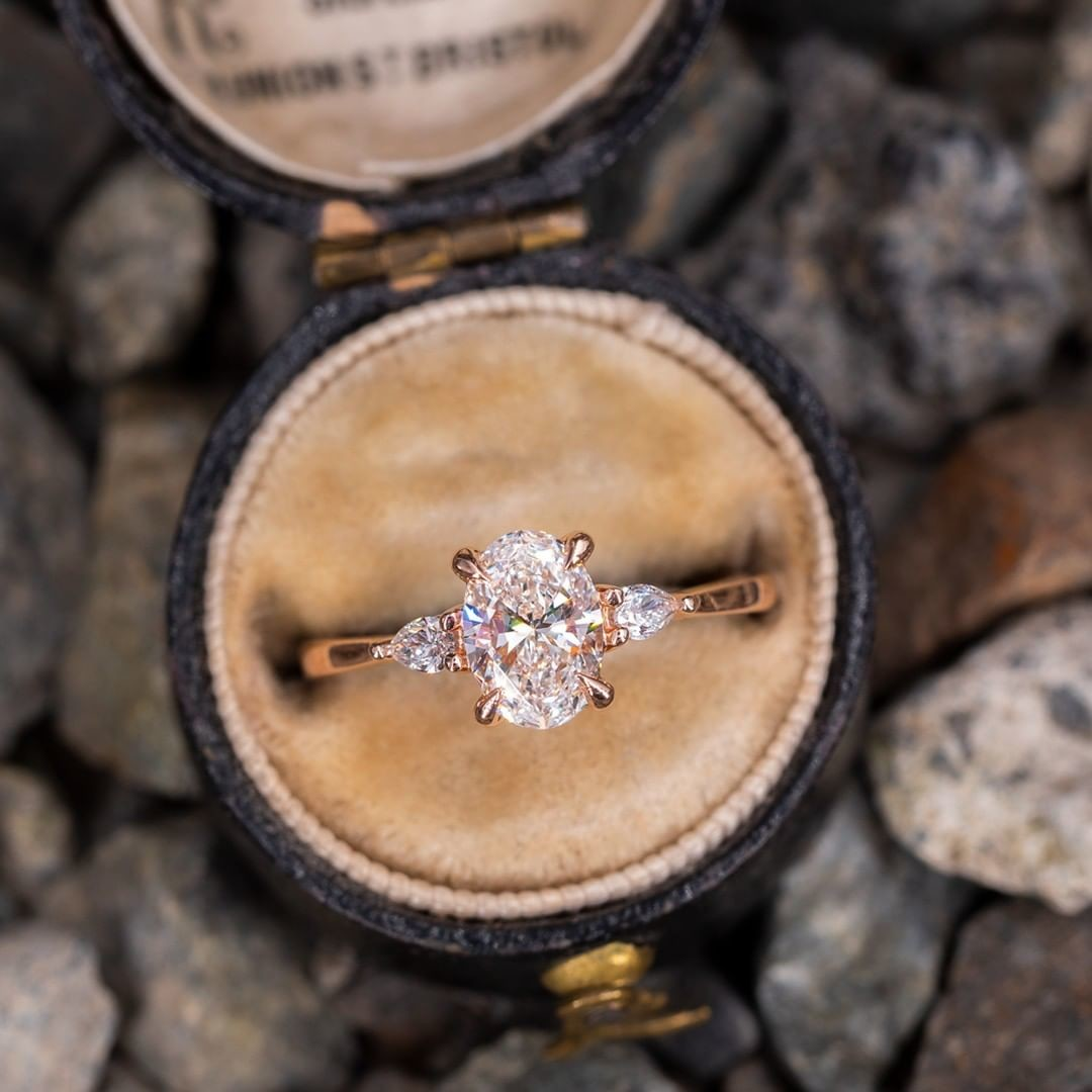 Oval Diamond with Pear Accents Rose Gold Engagement Ring