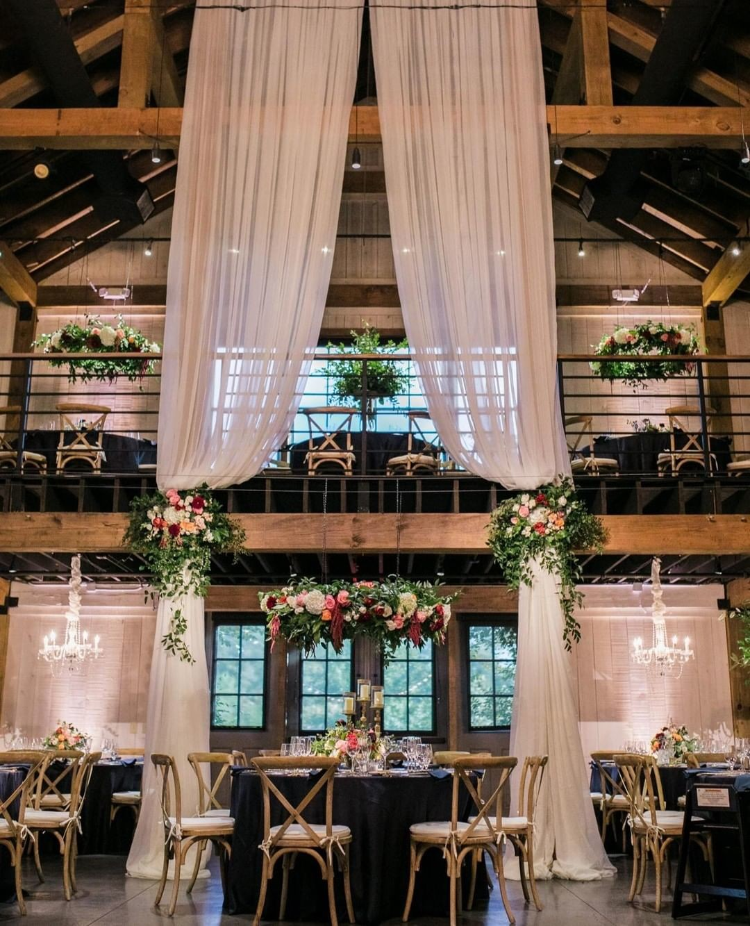 This reception made such a statement! The selection of suspended floral, mixed with elevated arrangements, and all tied in with speciality