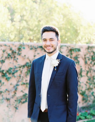 groom in white tie formal suit