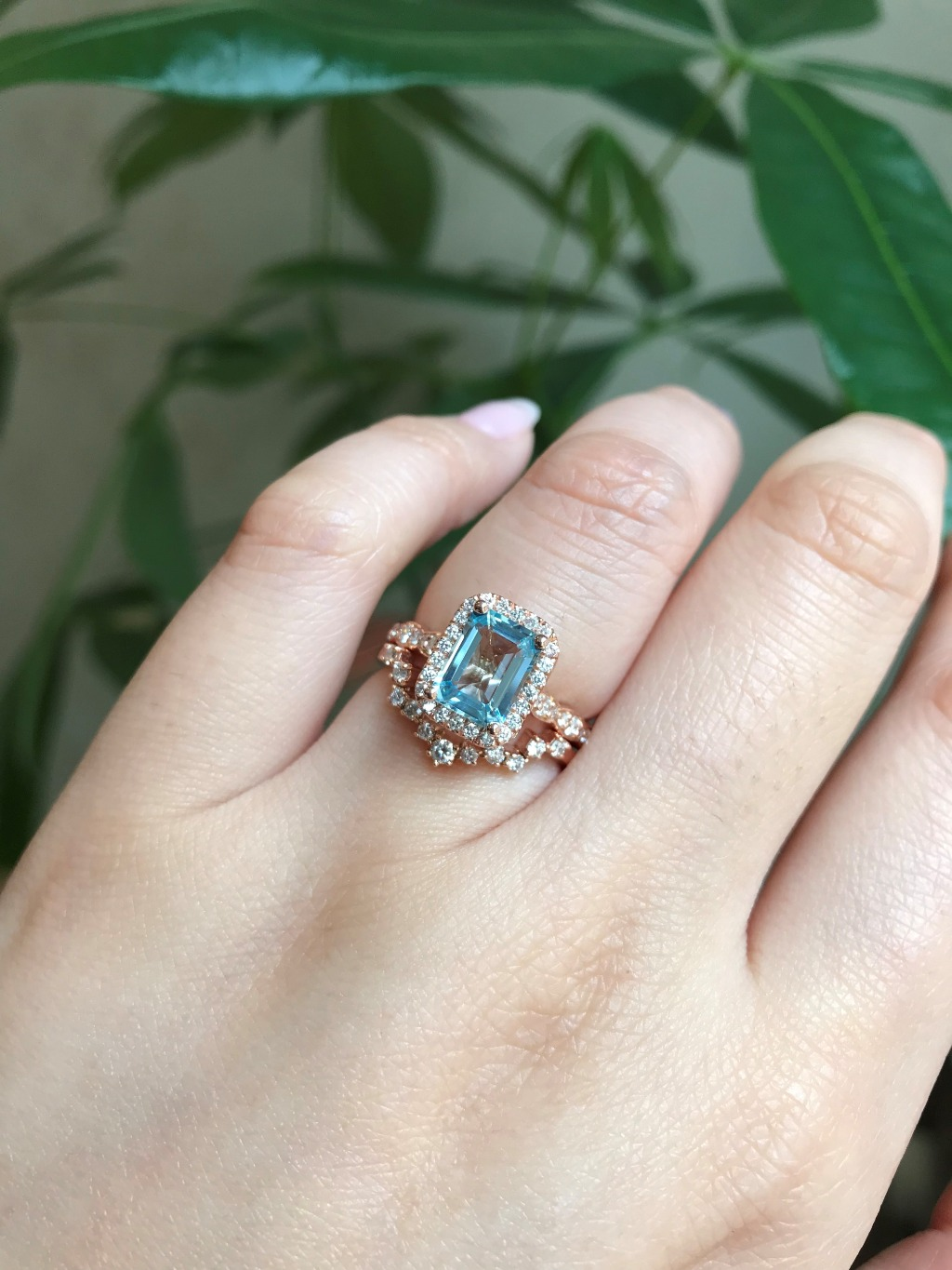 Elegant yet unique wedding set! This aquamarine bridal set features a halo diamond aquamarine engagement ring set in 14k rose gold