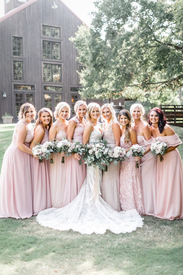 bridesmaids in mismatched blush gowns
