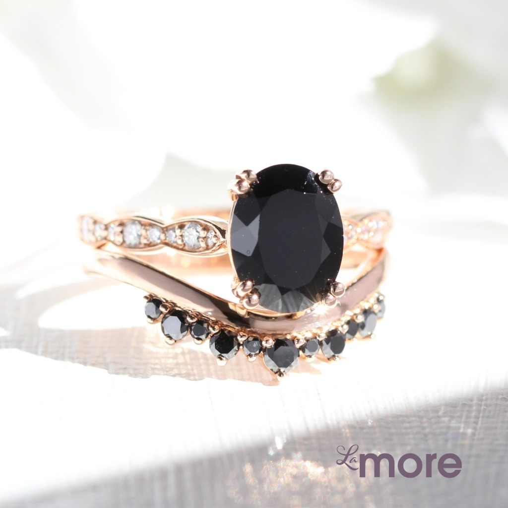 Gorgeously unique wedding set! This solitaire bridal set features an oval cut black spinel engagement ring set in 14k rose gold diamond
