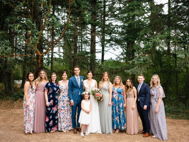 bridal party in mismatched floral dresses