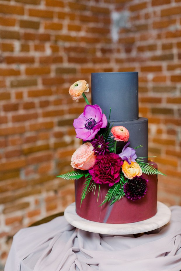charcoal grey and burgundy wedding cake with floral accents
