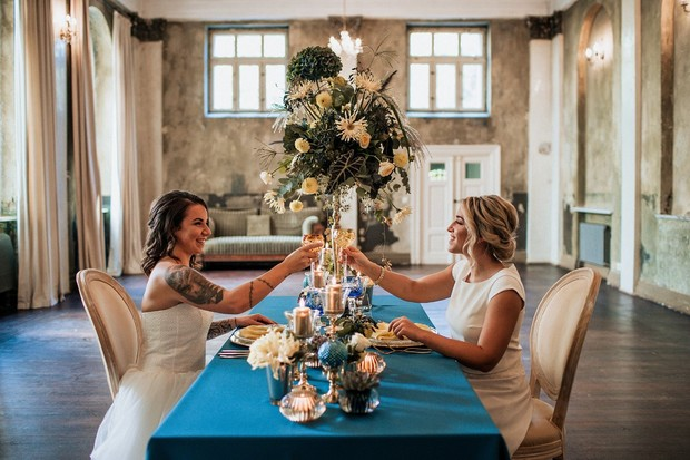 ballroom style wedding reception in blue and gold