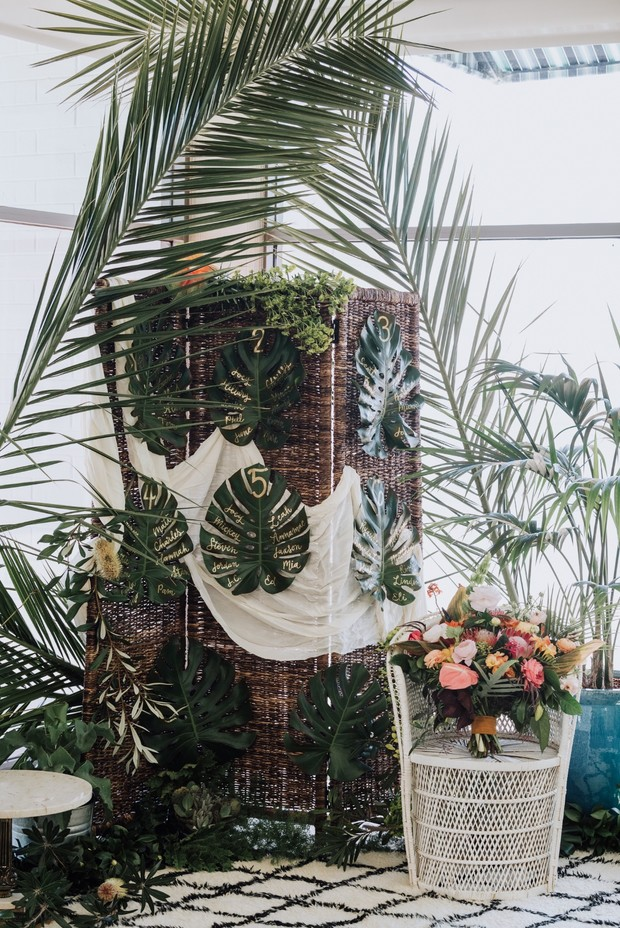 tropical monstera leaf wedding seating assignment