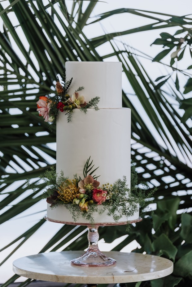 tropical floral accented wedding cake