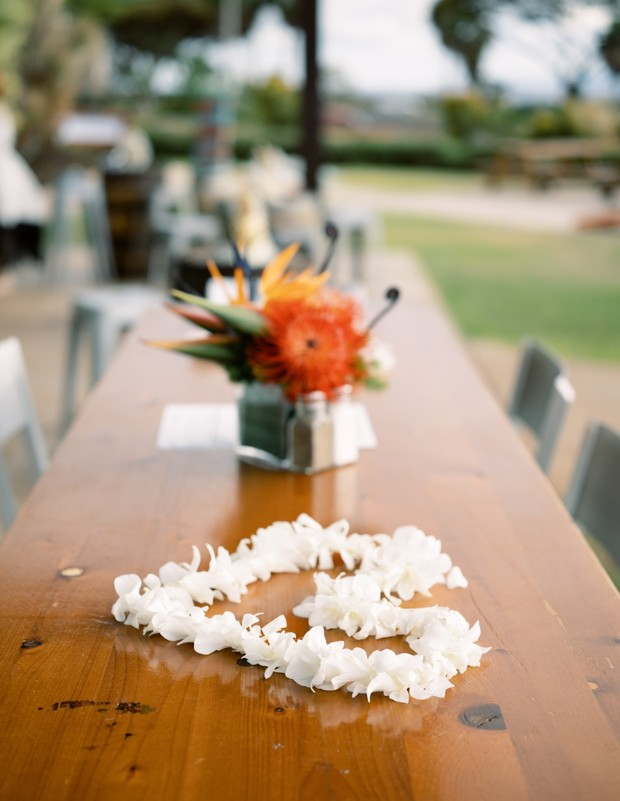 tropical flower and flower lei table decor