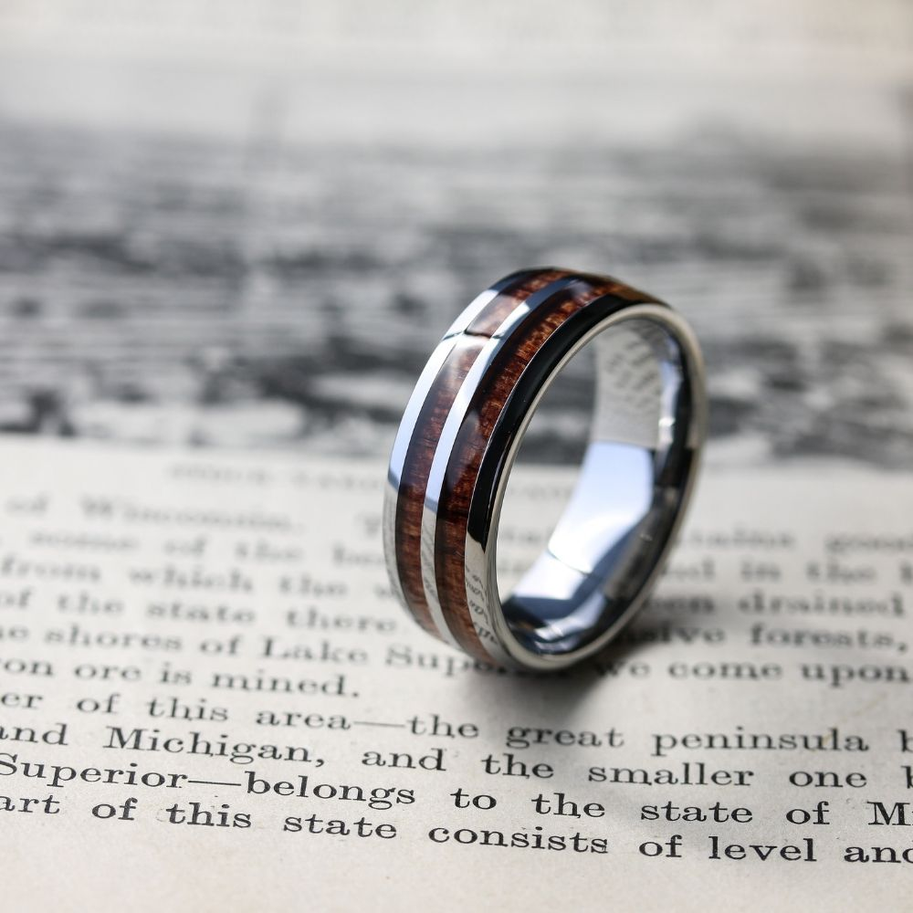 Mens silver wooden barrel ring. Crafted out of tungsten carbide and inlaid with natural koa wood. Also available in black.