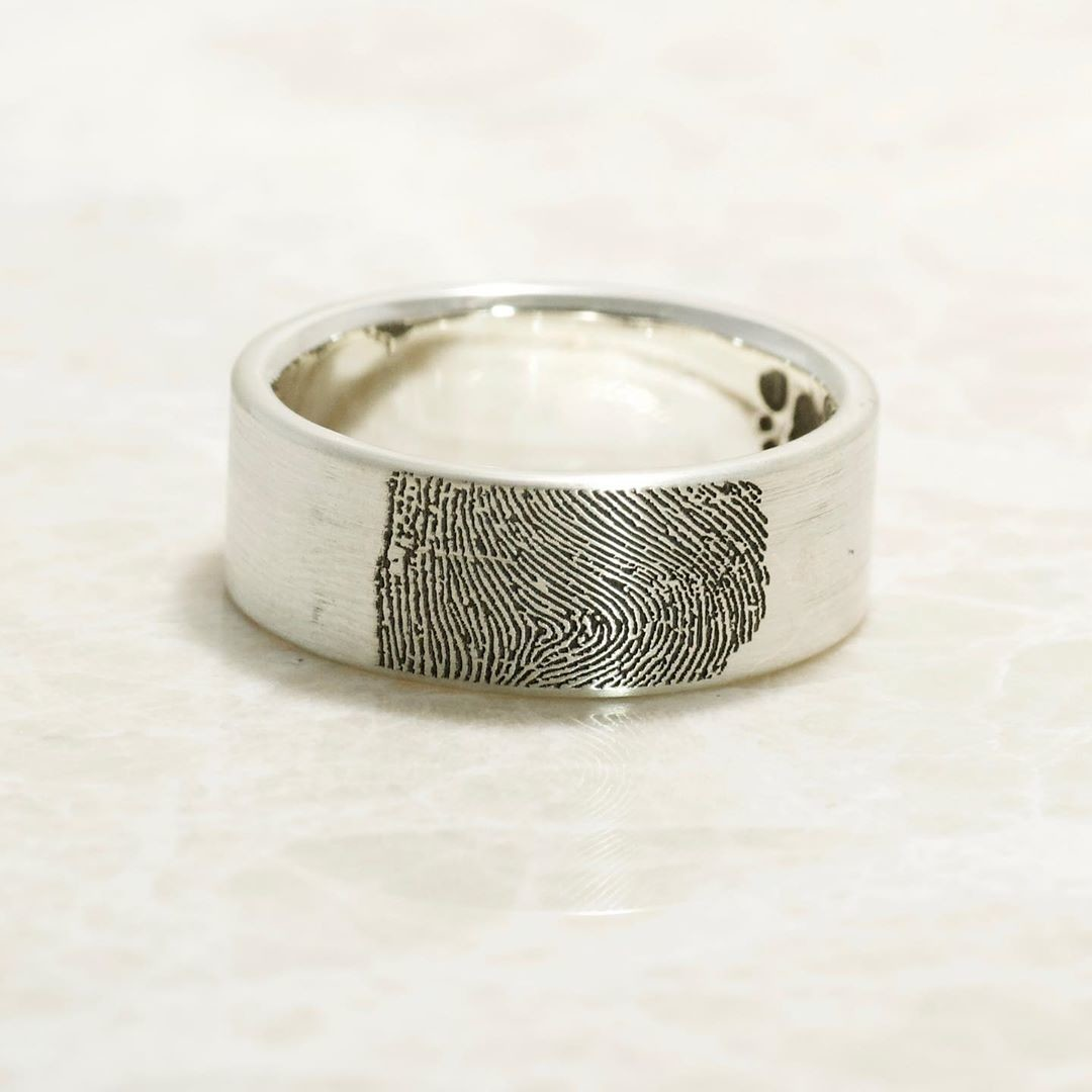 Handmade Father's Fingerprint Ring with baby footprint on the inside.
