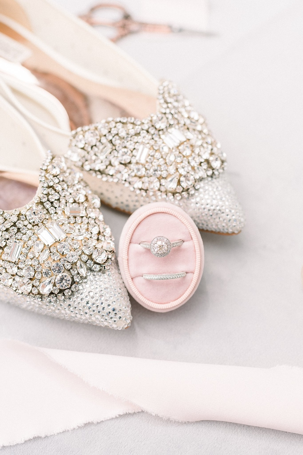 Gorgeous bridal details shot of Badgely Mischka shoes and wedding ring set.