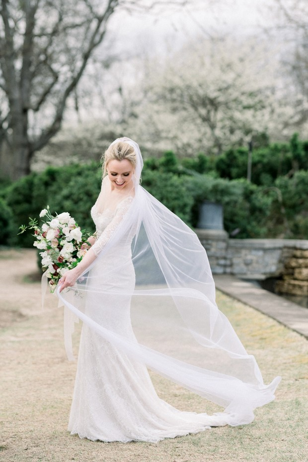 bride in a beautiful dress from Blue by Enzoani