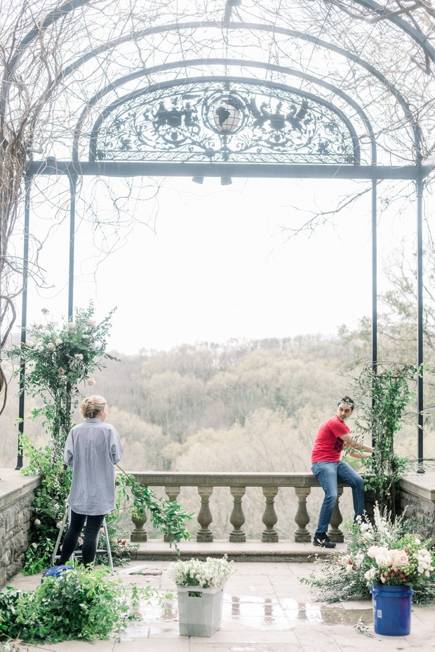 wedding couple florists assemble their floral decor