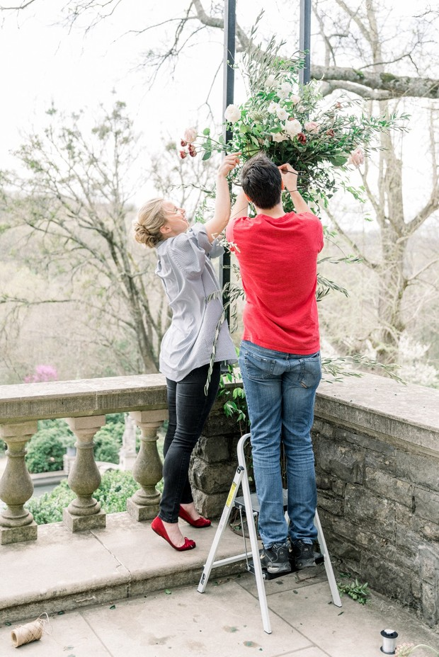wedding couple florists putting together floral decor