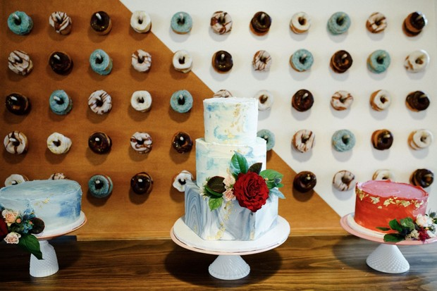 donut wall and wedding cake table