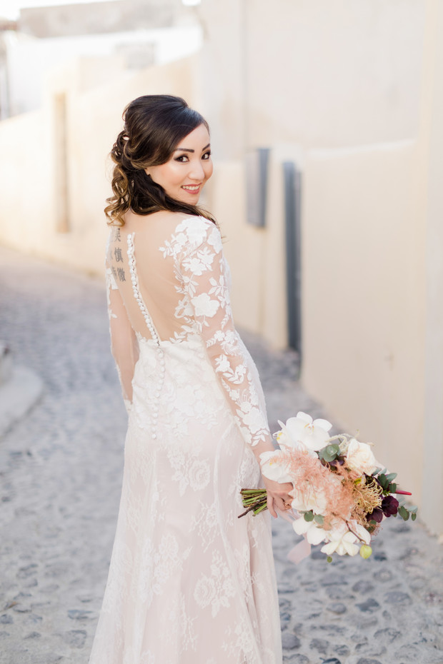 bride in sheer sleeved wedding dress