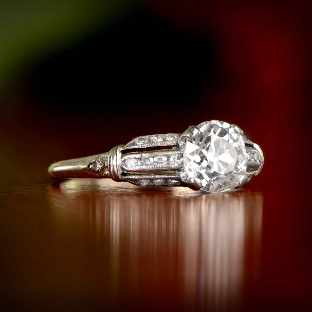 A rare Art Deco Era ring that features a stunning old European cut diamond in the center. Circa 1930.