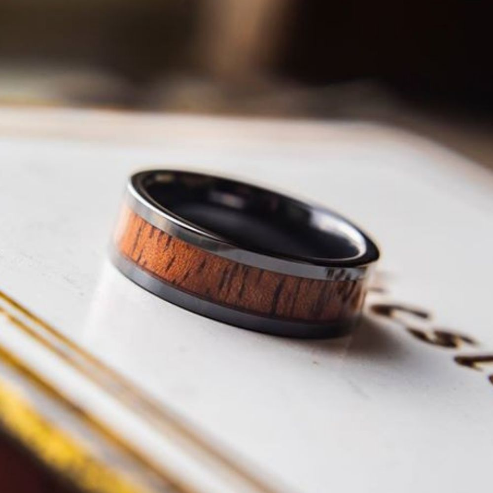 Mens 6mm black ceramic wooden wedding ring. The wood is 100% waterproof. Super durable and super comfy. The perfect wedding ring for