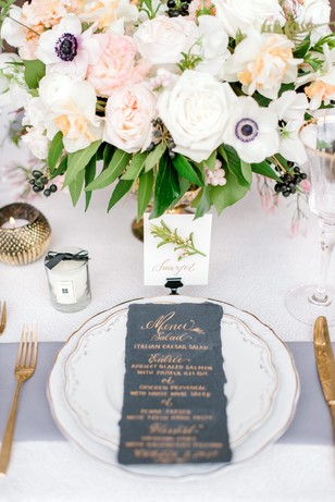 gold and white wedding table setting