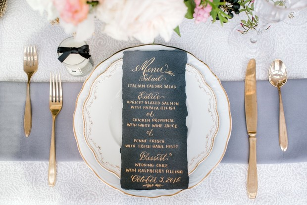 black menu with gold calligraphy