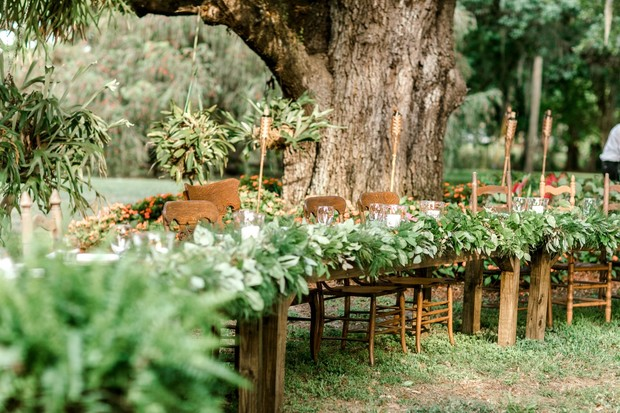 greenery covered wedding table
