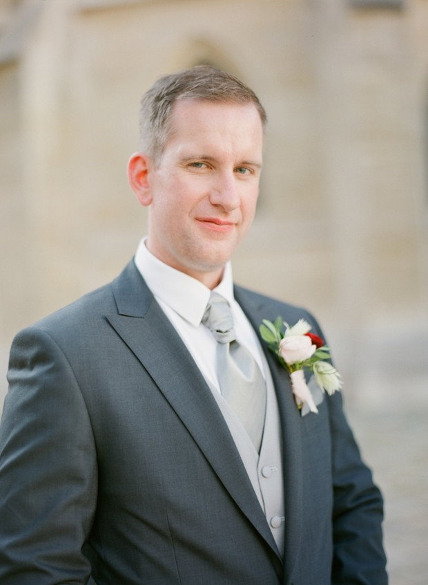 groom in grey and silver