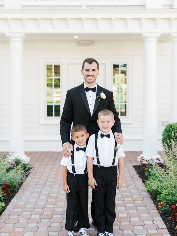 ring bearers in bowties and suspenders