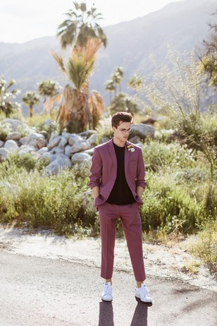 groom in mauve cropped suit and white adidas