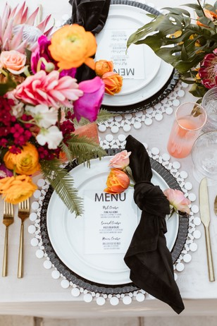gold and funky wedding place setting for a summer wedding
