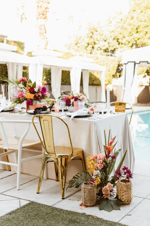 bright and bold tropical poolside wedding reception