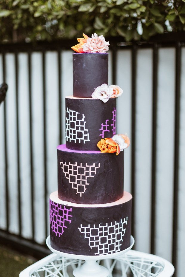 Black orange and purple wedding cake