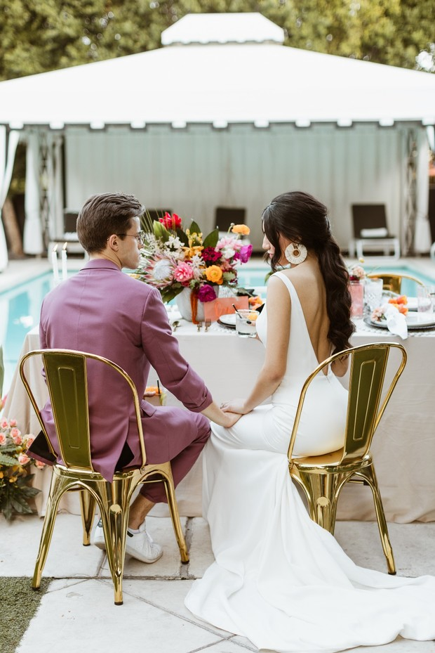 wedding couple with gold chrome wedding chairs