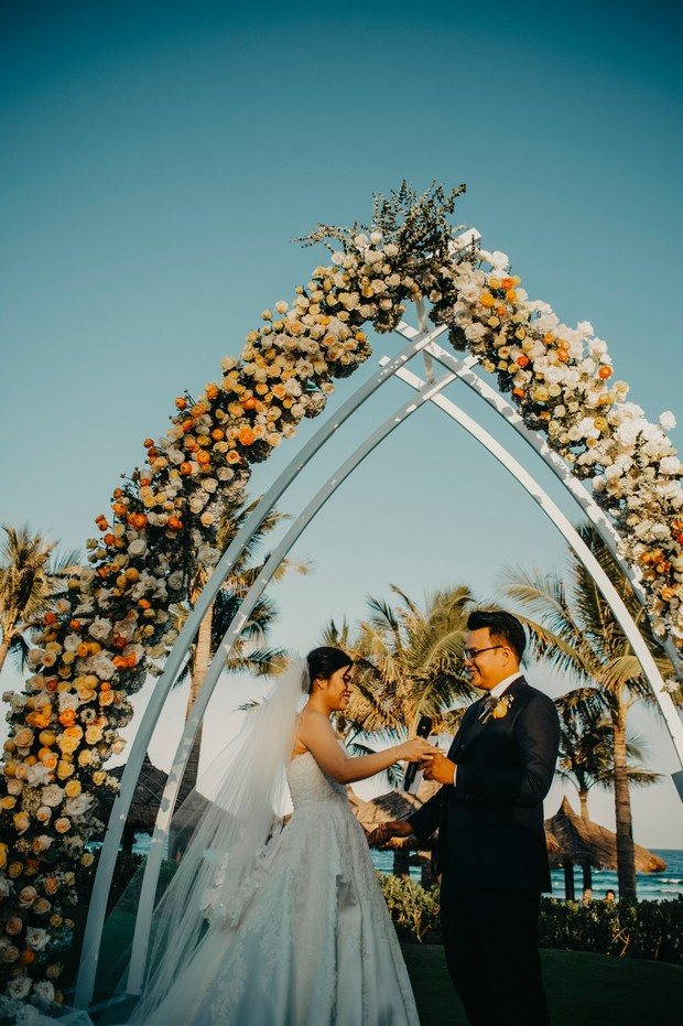 impressive yellow and white floral arch