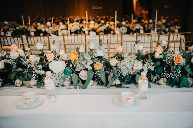 peach and white family style seating floral decor