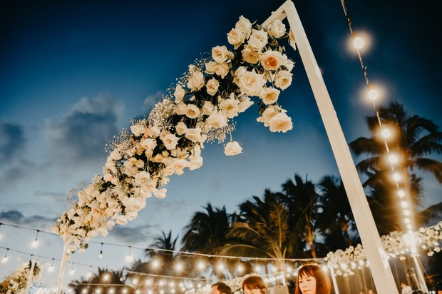 hanging floral decor over reception tables