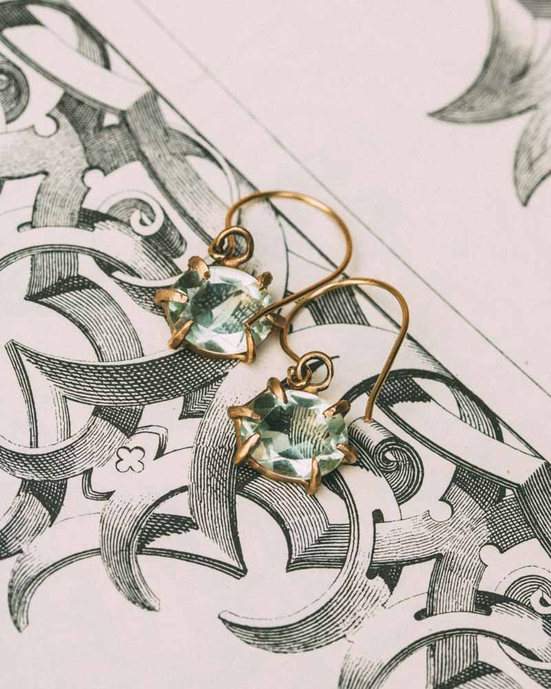 Boudica Green Amethyst Earrings. This pair of earrings feature green amethyst oval drops set in 14K yellow gold. Simplistic and edgy