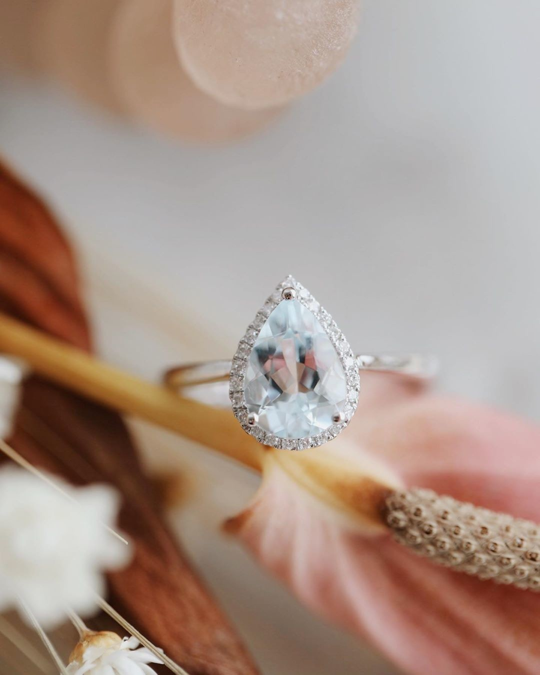 The perfect pear aquamarine ring with a diamond halo in 18k white gold, available now at our Tennyson location and online!