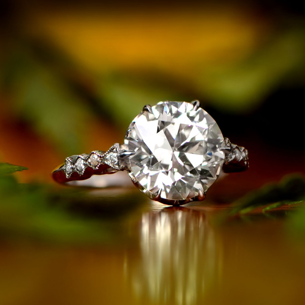 A very rare vintage diamond engagement ring, set in handcrafted platinum, and showcasing a 3.80-carat diamond in the center. Circa
