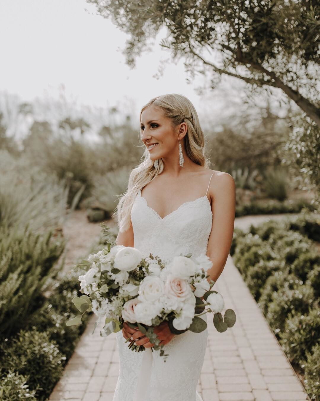This bride, simply elegant, full of grace, and exceptionally stylish. It's always fun to see what a statement a neutral palette bouquet