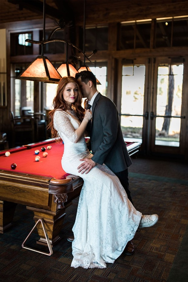bride in Maggie Sottero dress and converse shoes