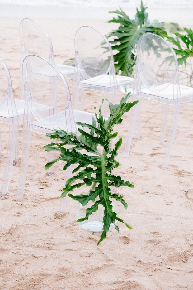 beach wedding decor with ghost chairs