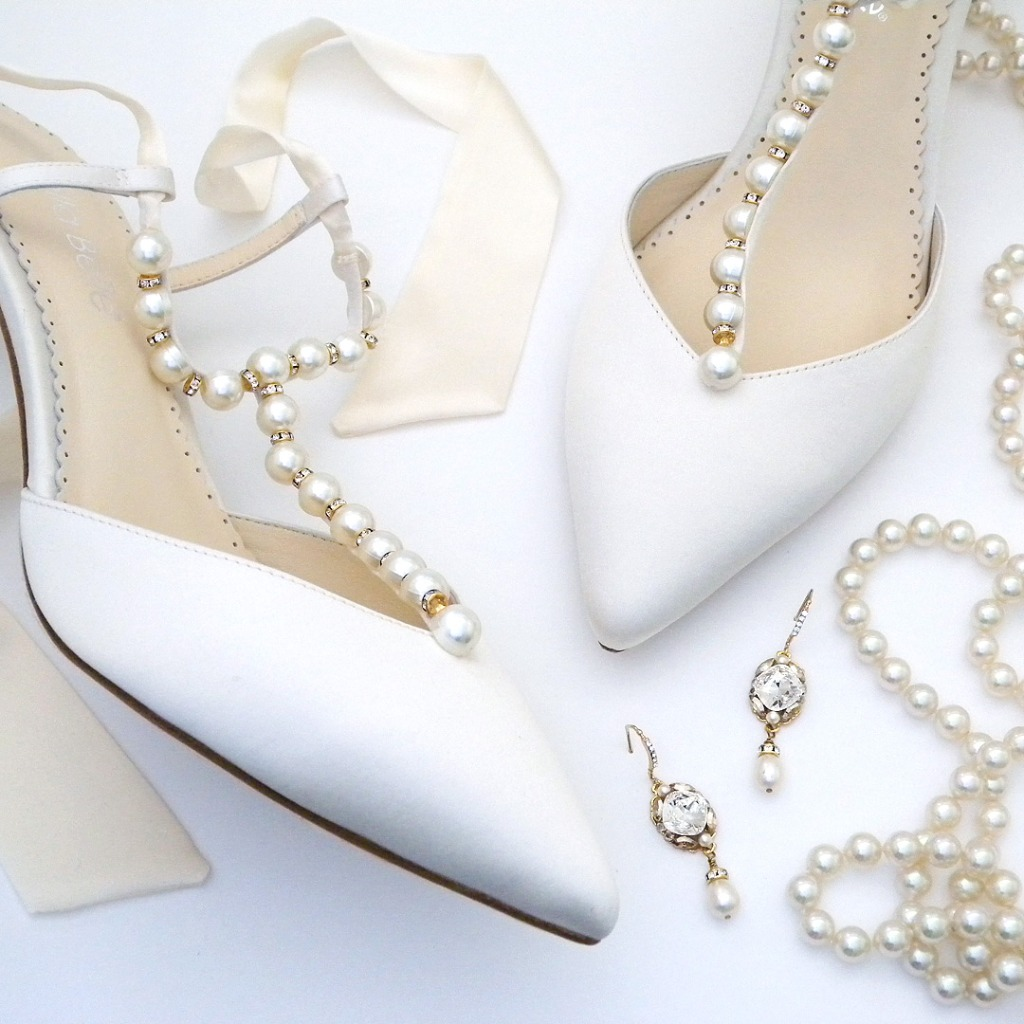 It's about pearls this month! June birthday gals are pearl girls. Shoes by Bella Belle Shoes, Earrings Haute Bride, Pearl Necklace